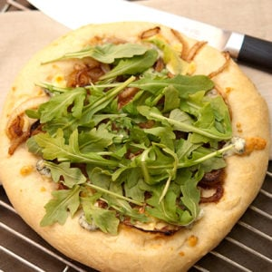 Arugula Pizza With Balsamic Glazed Onions and Blue Cheese